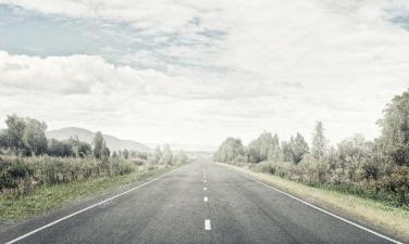 depositphotos_119978856-stock-photo-asphalt-road-to-horizon